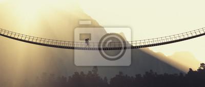 Naklejka Człowiek z plecakiem na liny mostu