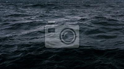 Naklejka Dark and deep blue ocean, Water surface