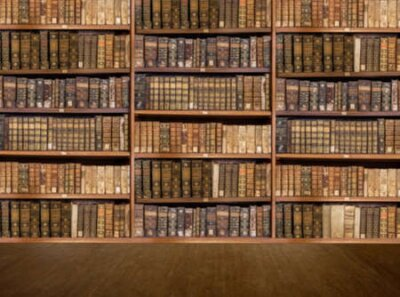 Naklejka Defocused and blurred image of old antique library books on shelves with wooden floor for use in video conferencing background