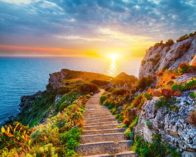 Naklejka Dramatic spring sunset on the the cape Milazzo panorama of nature reserve Piscina di Venere.