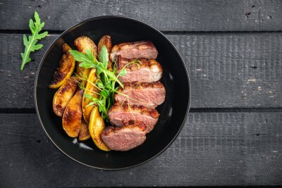 Naklejka duck breast meat and garnish poultrysecond course side dish fresh ready to eat meal snack on the table copy space food background