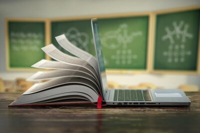 Naklejka E-learning online education or internet  encyclopedia concept. Open laptop and book compilation in a classroom.
