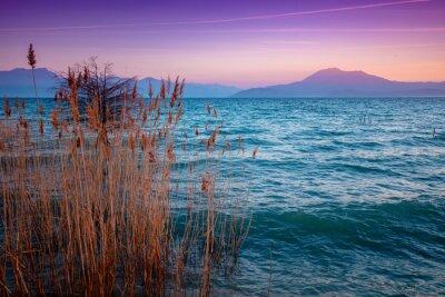 Early morning, sunrise over the lake.  Garda lake (Lago di Garda), Italy, Europe