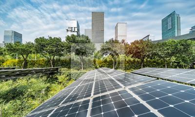 Naklejka Ecological energy renewable solar panel plant with urban landscape landmarks