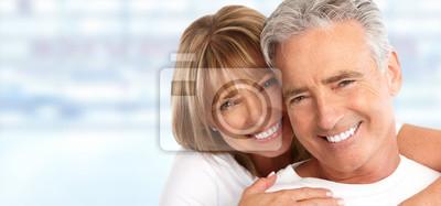 Naklejka Elderly couple with white teeth.