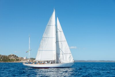 Naklejka Elegant old italian style sailboat, on a wonderful blue sea, Sardinia, Italy