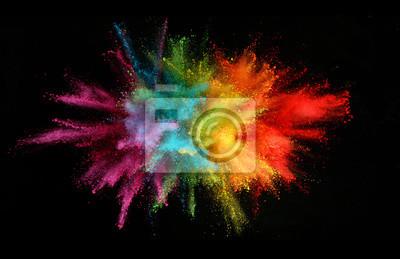 Naklejka Explosion of colored powder isolated on black background