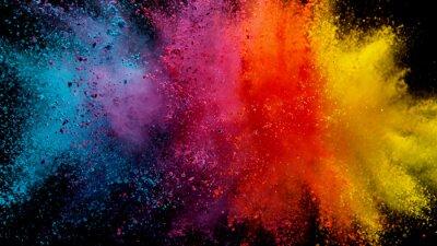 Naklejka Explosion of colored powder on black background
