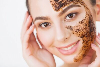 Naklejka Face Skincare. Young Charming Girl Makes a Black Charcoal Mask on Her Face