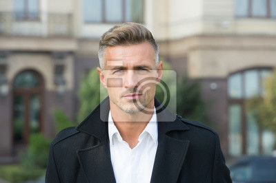 Naklejka Facial care and ageing. Beauty of mature face. Traits and behaviors that make men more appealing. Attractive mature man. Mature guy with grey hair and bristle. Men get more attractive with age