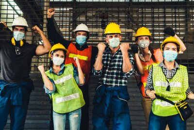 Naklejka Factory workers with high morale to fight the outbreak of Novel Corona Virus Disease 2019 or COVID-19 .