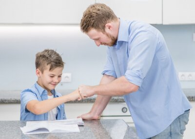 Naklejka Father praises son for well done homework