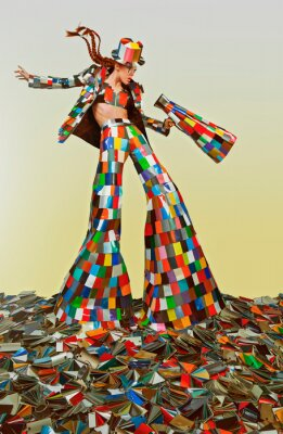 Naklejka Female circus master dressed in a colorful suit and holding a megaphone, standing in the middle of a bunch of color samples