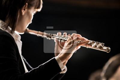 Naklejka Female flutist performing