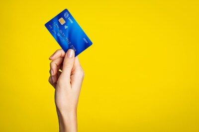Naklejka Female hand holding bank credit card