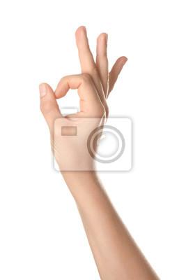 Naklejka Female hand showing OK gesture on white background