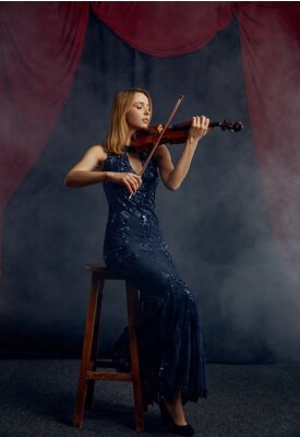 Naklejka Female violonist with bow and violin, solo concert