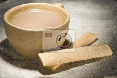 Naklejka Filiżanka kawy mleka z chrupiący kijami