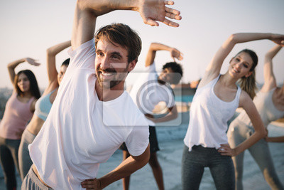 Naklejka Fitness, sport, friendship and healthy lifestyle concept . Group of happy people exercising