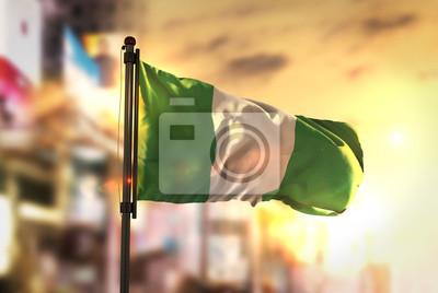 Naklejka Flaga Nigerii Przeciw Miastu Rozmyte Tło W Sunrise Backlight