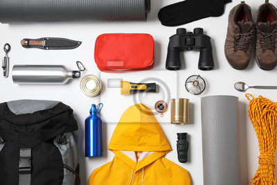 Naklejka Flat lay composition with different camping equipment on white background