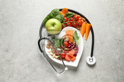 Naklejka Flat lay composition with plate of products for heart-healthy diet on grey background