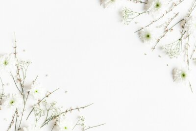 Naklejka Flowers composition. White flowers on white background. Spring concept. Flat lay, top view, copy space