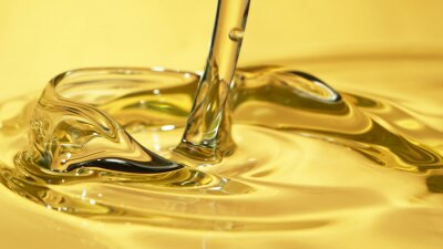 Naklejka Freeze motion of pouring oil