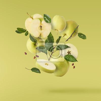 Naklejka fresh apple Flying in air over background