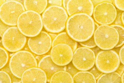 Naklejka Fresh lemon slices pattern backgrond, close up