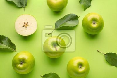 Naklejka Fresh ripe apples on color background