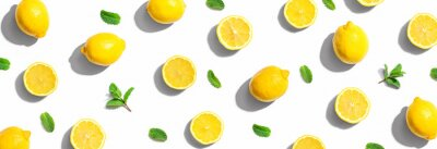 Naklejka Fresh yellow lemons with mints overhead view