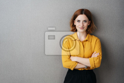 Naklejka Friendly confident young woman over grey