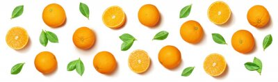 Naklejka Fruit pattern arranged of oranges and orange leaves on white background. Lay out background.