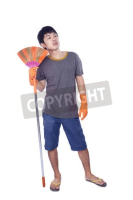 Naklejka Full length portrait of a male cleaner with a broom giving thumb up isolated on white background