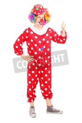 Naklejka Full length portrait of a smiling happy clown in red costume giving thumb up isolated on white background
