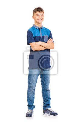 Naklejka Full length portrait of young caucasian teen boy isolated on white background. Funny teenager with arms folded. Handsome child looking at camera and smiling.