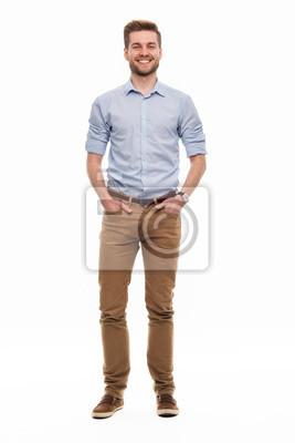 Naklejka Full length portrait of young man standing on white background