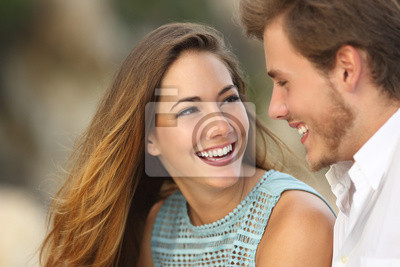 Naklejka Funny couple laughing with a white perfect smile