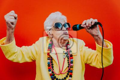 Naklejka Funny grandmother portraits. Senior old woman dressing elegant for a special event. Rockstar granny on colored backgrounds