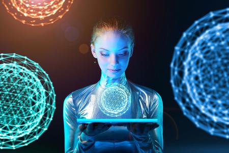 Naklejka Futurystyczna cyber młoda kobieta w srebnym ubraniowym mienie oświetleniowym panelu w jej rękach z rozjarzoną poligonalną abstrakcjonistyczną sferą z abstrakcjonistycznymi sferami przy tłem