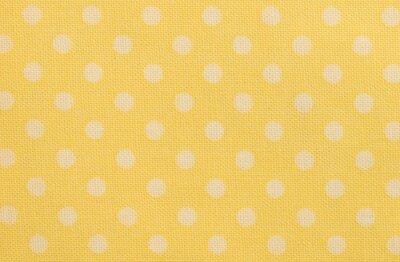 Naklejka Gelbes Tischtuch mit weißen Tupfen Makro