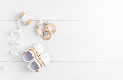 Naklejka Gender neutral baby shoes and accessories. Organic cnewborn fashion, branding, small business idea