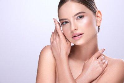 Naklejka Girl at white background with nude make up