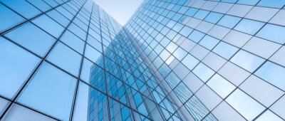 Naklejka glass facades of modern office buildings and reflection of blue sky