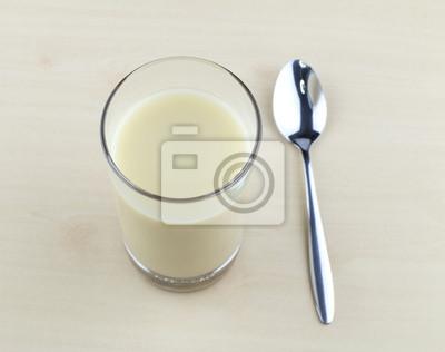 Naklejka Glass of soy milk with spoon
