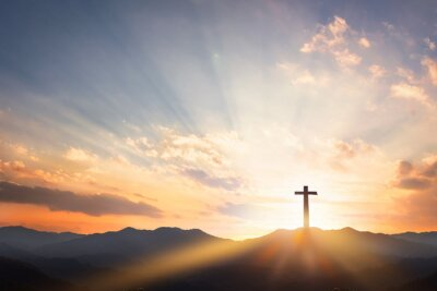 Naklejka Good Friday concept: cross with sunset in the sky background