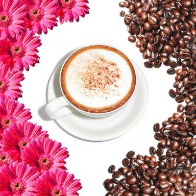 Naklejka gorąca filiżanka cappuccino ozdobione kwiatami i ziarna kawy