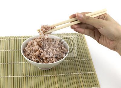 Naklejka Gotowany ryż został zaciśnięty przez chopstick