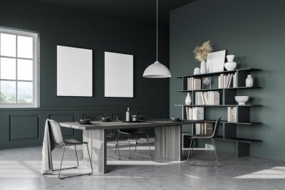 Naklejka Green dining room corner with long table and two posters